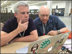 Everyone's a learner at CMK! Faculty members Brian Smith & Brian Harvey work out a bug.